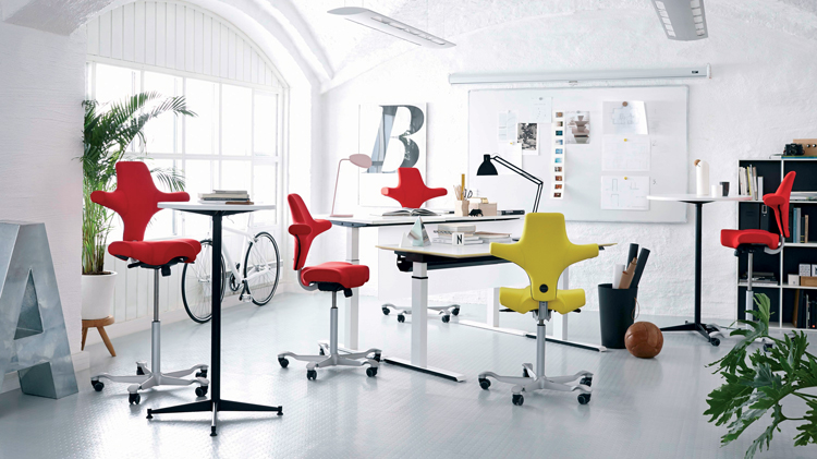 The ergonomic HÅG Capisco designed by Peter Opsvik. 'The Saddle Chair' – was designed modelled on the horse rider's dynamic seating position.
