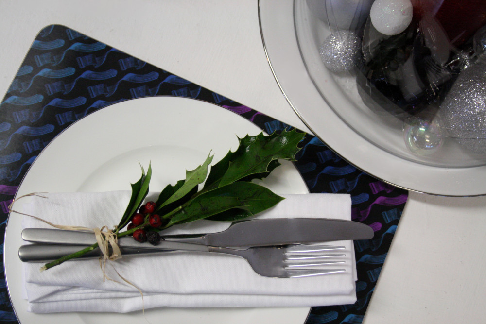Stylish contemporary placemats bring a touch of class to any table this Christmas.